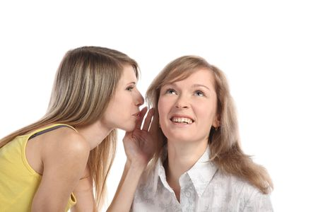 Two girlfriends talk. Close up. White background. It is isolated. Stock Photo - 5878852