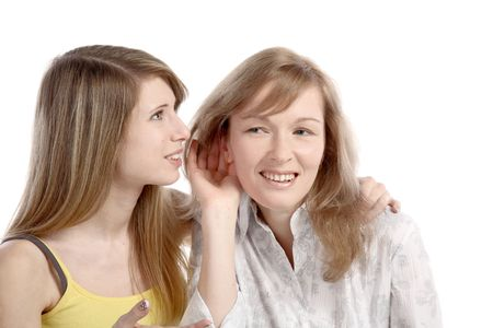 Two girlfriends talk. Close up. White background. It is isolated. Stock Photo - 5878853