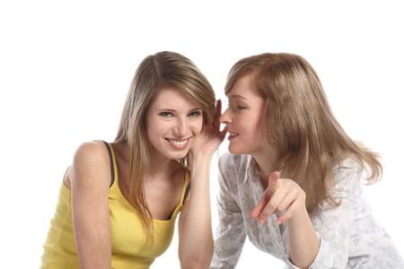 Two girlfriends talk. Close up. White background. It is isolated. Stock Photo - 5878861
