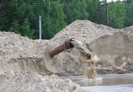 Dirty water flows from a pipe. Toxic production wastes Stock Photo - 5961719