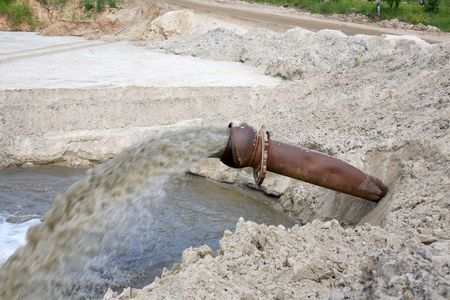 Dirty water flows from a pipe. Toxic production wastes Stock Photo - 5961717