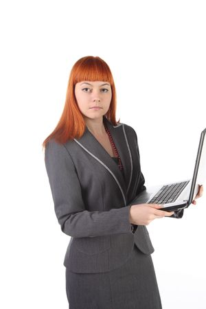 beautiful girl with the laptop. It is isolated. White background. photo