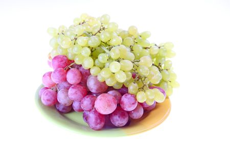Pink grape cluster with leaves, isolated Stock Photo - 6486491