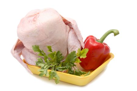 Fresh hen with vegetables on a chopping board. isolation Stock Photo - 6808064
