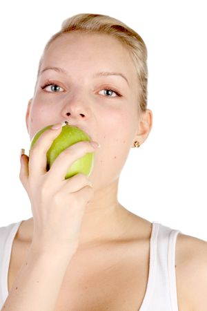 girl bites off from the big green apple Stock Photo - 7028201