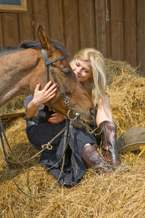 horse blonde: beautiful girl in style of the country Stock Photo