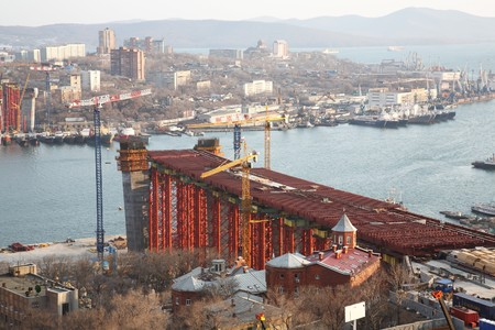 european economic community: Vladivostok. Bridge building through a bay the Gold Horn to the EUROPEAN ECONOMIC COMMUNITY summit in 2012 Stock Photo
