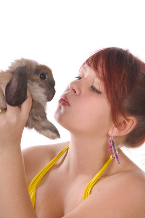 beautiful girl with a rabbit . On a white background. photo