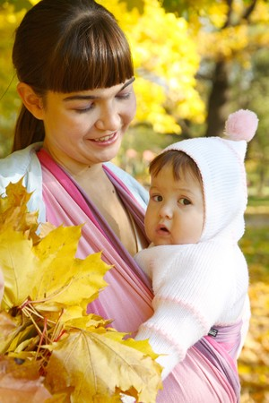 Walk with the child in a baby sling. Stock Photo - 8094379