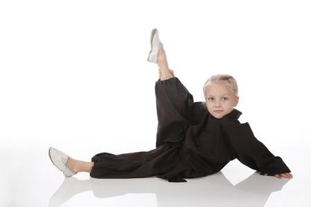 girl - karateka in a black kimono on a white background photo