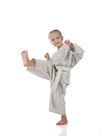 aikido: girl - karateka in kimono on a white background