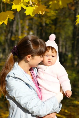 Walk with the child in a baby sling. photo