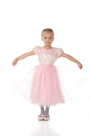 little girl in a pink elegant dress.White background photo