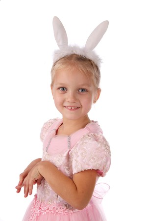 little girl in a pink dress with ears of a rabbit on a head photo