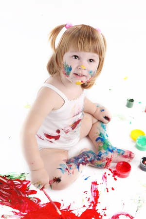little girl be daubed playing with colors