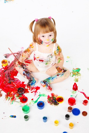 daubed: little girl be daubed playing with bright colors