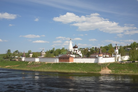 olden day: Orthodox monastery on river bank Stock Photo