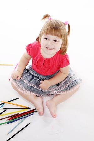 little girl draws color pencils photo