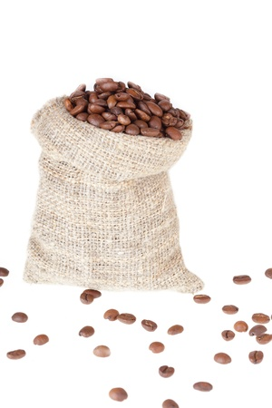 Linen bag filled with coffee grains photo