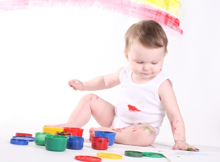 little girl bedaubed with bright colors Stock Photo - 8673095