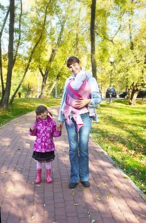 Mum with two children on walk in park Stock Photo - 8967038