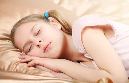 beautiful girl sleeps on silk linen photo