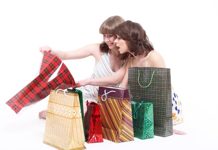 Two happy friends with purchases. It is isolated, a white background. Stock Photo - 9271409