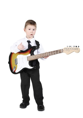 little boy with an electroguitar in hands. Stock Photo - 9300236