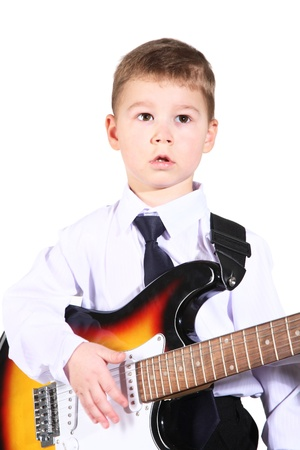 little boy with an electroguitar in hands. Stock Photo - 9303948
