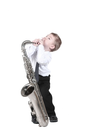 little boy with a saxophone Stock Photo
