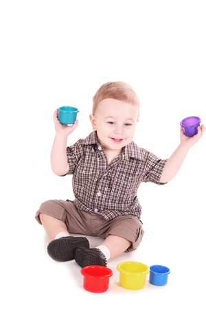 15 18: small child plays with color toys. It is isolated, a white background Stock Photo