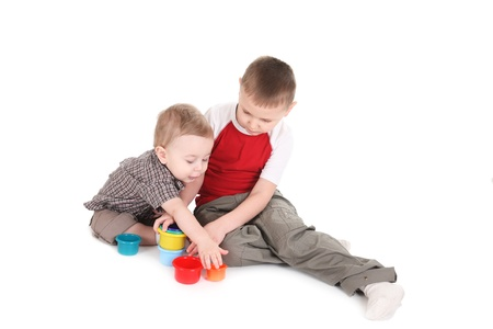 2 5 months: Children play with color toys. It is isolated, a white background Stock Photo