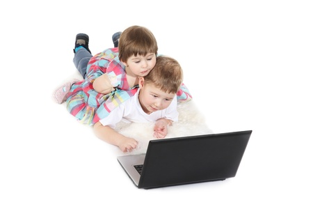 brother and the sister look cartoon films on a laptop Stock Photo - 9480316