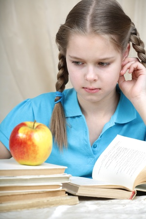 tired ten years' schoolgirl learns lessons Stock Photo - 9487299