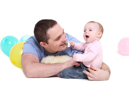 father plays with the eight-monthly daughter. It is isolated on a white background. photo