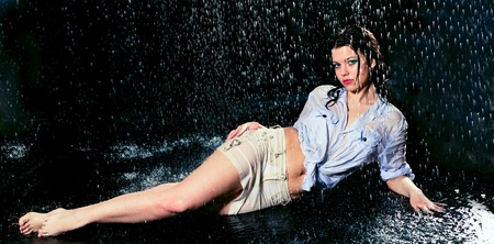 beautiful girl in the rain against a dark background Stock Photo - 9573968