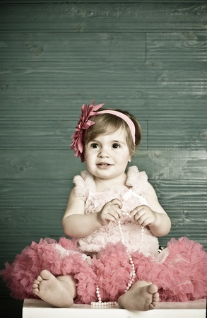 little girl barefoot: elegant little girl in a bright pink dress