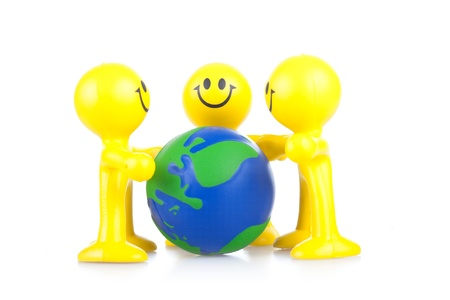 Smiling toy little men hold globe. It is isolated, a white background Stock Photo - 9791100