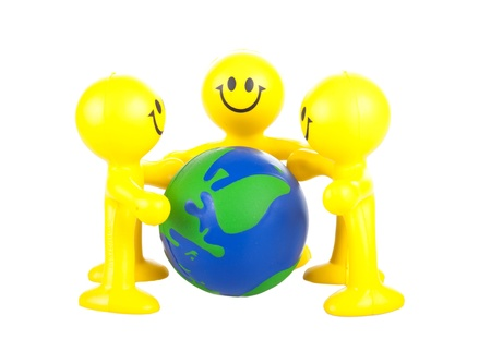 Smiling toy little men hold globe. It is isolated, a white background Stock Photo - 9791081