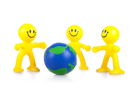 Smiling toy little men hold globe. It is isolated, a white background Stock Photo - 9791093