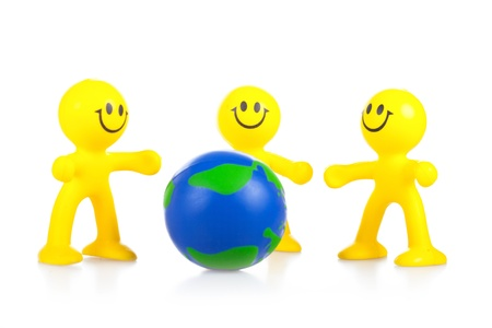 Smiling toy little men hold globe. It is isolated, a white background Stock Photo - 9791080