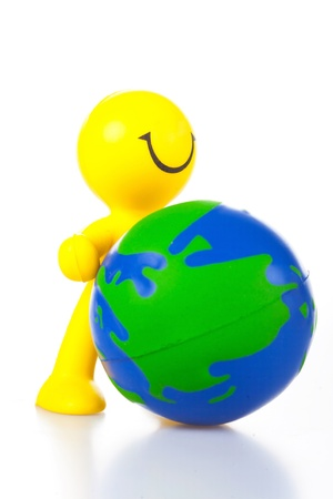 petit bonhomme: smiling toy little man rolls forward globe. It is isolated, a white background