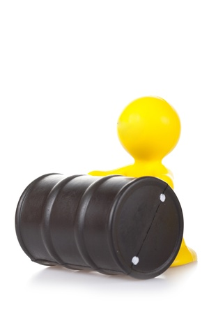 petit bonhomme: smiling toy little man rolls. The oil recovery concept Banque d'images