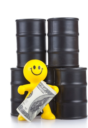 supremacy: toy smiling little man costs at butts with oil and holds many money. The world supremacy concept oil-extracting the companies