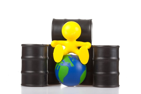 supremacy: toy smiling little man sits next on butts to oil the globe. The world supremacy concept oil-extracting the companies