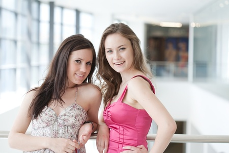 Two friends with purchases in the big shopping center Stock Photo - 9918807