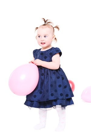 hairdress: little girl with a ridiculous hairdress plays with color balloons