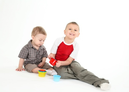 15 18: Children play with color toys. It is isolated, a white background Stock Photo
