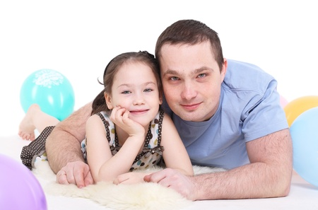father plays with the daughter. It is isolated on a white background. photo