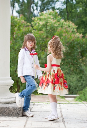 Two children (the boy and the girl) on walk in park in the summer. Stock Photo - 10103639